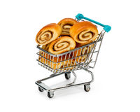 Shopping cart filled with buns. Shopping cart filled with cinnamon buns Stock Photos