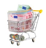 Shopping cart filled with cash Royalty Free Stock Image