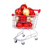 Shopping cart filled with Christmas balls Royalty Free Stock Photos