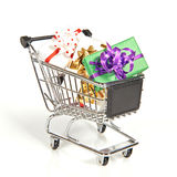 Shopping cart filled with christmas gifts Royalty Free Stock Image