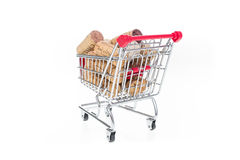 Shopping cart filled with corks wine shop selling wine online co Stock Image