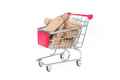 Shopping cart filled with corks wine shop selling wine online co Royalty Free Stock Photography
