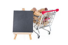 Shopping cart filled with corks wine shop selling wine online co Royalty Free Stock Photo