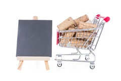 Shopping cart filled with corks wine shop selling wine online co Royalty Free Stock Photos
