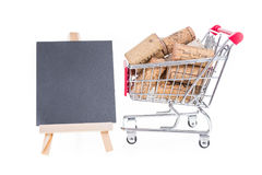 Shopping cart filled with corks wine shop selling wine online co Stock Photos
