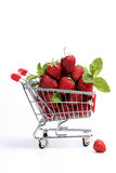 Shopping cart filled with fresh strawberries Royalty Free Stock Image
