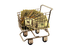 Shopping Cart filled money. Shopping cart made of metal used for carrying groceries filled with money in the form of many large bills Royalty Free Stock Images