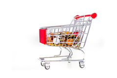 Shopping cart filled with money. Consumerism symbolic conceptual Royalty Free Stock Image
