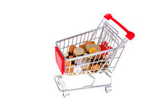 Shopping cart filled with money. Consumerism symbolic conceptual Royalty Free Stock Images