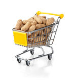 Shopping Cart Filled with Peanuts. Isolated On White Background Stock Photo