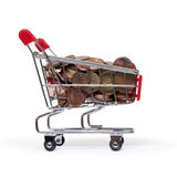 A shopping cart is filled with well-euro coins Royalty Free Stock Photos