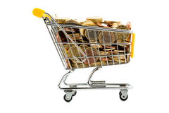 Cart and euro coins. A shopping cart is filled with well-euro coins, symbolic photo for purchasing power and consumption Royalty Free Stock Image