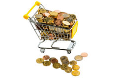 Shopping cart. A shopping cart is filled with well-euro coins, symbolic photo for purchasing power and consumption Royalty Free Stock Photo