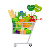 Shopping cart with food Stock Images
