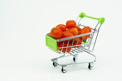 Shopping cart with Fresh Cherry Tomatoes, isolated on white back. Shopping cart with Fresh Cherry Tomatoes isolated on white background Royalty Free Stock Images