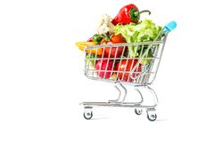 Shopping cart with fresh vegetables close-up isolated. On white background Royalty Free Stock Photo