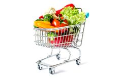 Shopping cart with fresh vegetables close-up isolated. On white background Royalty Free Stock Photography