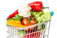 Shopping cart with fresh vegetables close-up isolated. On white background Stock Images