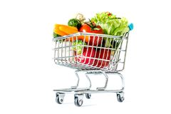 Shopping cart with fresh vegetables close-up isolated. On white background Stock Photography