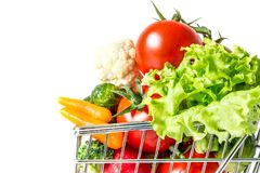 Shopping cart with fresh vegetables close-up isolated. On white background Stock Photos