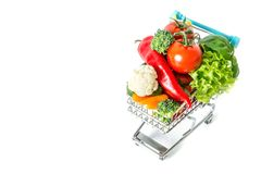 Shopping cart with fresh vegetables close-up isolated. On white background Stock Image