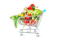 Shopping cart with fresh vegetables close-up isolated. On white background Royalty Free Stock Photos