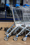 Shopping cart in front of a supermarket. In front of a supermarket shopping carts are ready for customers royalty free stock image