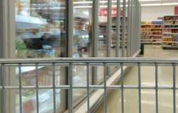 Shopping cart in frozen foods aisle Stock Image