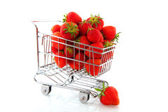 Shopping cart with fruit. Shopping cart with fresh strawberries isolated over white Royalty Free Stock Images