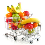 Shopping cart with fruit. Shopping carts from the supermarket filled with fresh fruit Royalty Free Stock Photo