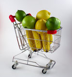 Shopping cart with fruit Stock Images