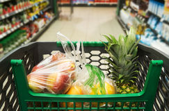 Shopping cart with fruit Stock Image