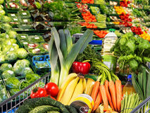 Shopping cart with fruit and vegetables. In a supermarket Stock Photo