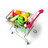 Shopping cart with fruits and vegetables isolated Royalty Free Stock Image