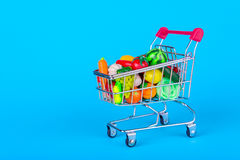 Shopping cart with fruits and vegetables Royalty Free Stock Photo