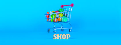 Shopping cart with fruits and vegetables Royalty Free Stock Image