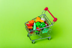 Shopping cart with fruits and vegetables Royalty Free Stock Photos
