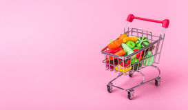 Shopping cart with fruits and vegetables Stock Photo