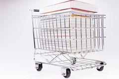 Shopping cart full of books royalty free stock photo