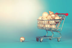 Shopping cart full of christmas decoration balls in vintage styl Royalty Free Stock Image