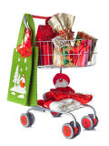 Shopping cart full of Christmas gifts Royalty Free Stock Image