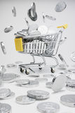 Shopping cart full of coins. Toy's Shopping cart full of coins Royalty Free Stock Image