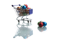 Shopping cart full with colorful christmas balls Stock Photography