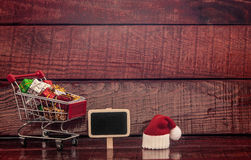 Shopping cart full of colorful gift boxes Royalty Free Stock Photo
