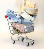 Shopping cart full of crumpled euro money Royalty Free Stock Photos