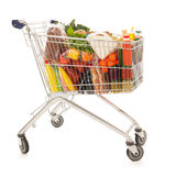 Shopping cart full dairy grocery. Shopping cart full with dairy grocery products isolated over white background Stock Photo