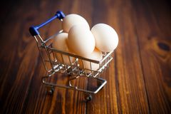Shopping cart full with eggs Stock Image