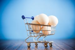 Shopping cart full with eggs Stock Photo