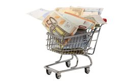 Shopping cart full of euro banknotes Stock Images