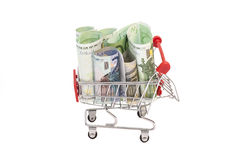 Shopping cart full of euro banknotes Stock Photos